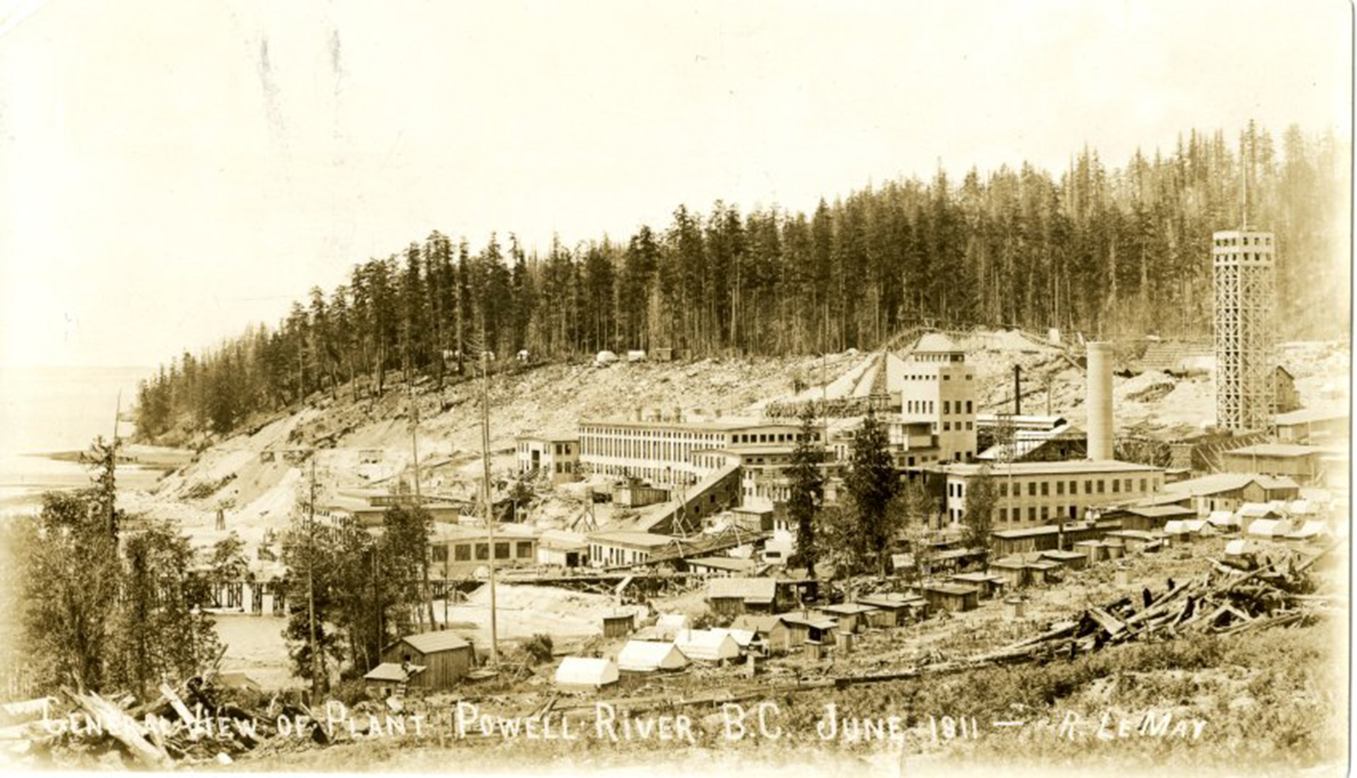 The Powell River Company Mill in 1911 with bunkhouses in foreground.